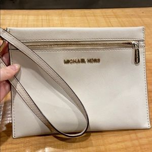 Cream color Michael kors wristlet purse